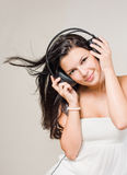 Happy relaxed brunette listening to music. Stock Photos