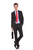 Happy and relaxed business man wit briefcase Royalty Free Stock Photography