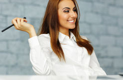 Happy relaxed businesswoman in office Royalty Free Stock Image