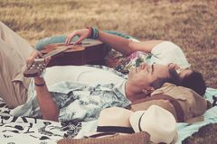 Happy and relaxed cheerful couple laying down on the natural grass and enjoy the outdoor leisure activity with a good weather in royalty free stock photo