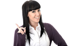 Happy Relaxed Cheerful Pleased Attractive Woman Smiling and Pointing Royalty Free Stock Image