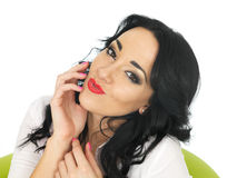 Happy Relaxed Content Dreamy Young Hispanic Woman Being Flirtatious and Pouting. Happy Relaxed Content dreamy Young Woman with long black curly hair and hispanic stock photos