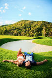 Happy relaxed couple in love laying down on the grass overhead. Happy young relaxed couple in love laying down on the grass overhead Royalty Free Stock Photo