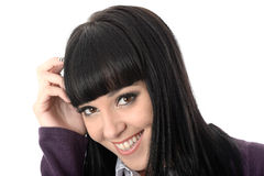 Happy Relaxed Coy Woman Laughing and Smiling. Happy Relaxed coy Young Woman with long black straight hair and hispanic or european features, looking at camera royalty free stock photo
