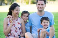 Happy relaxed family park outdoors Stock Photos