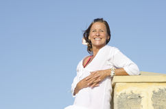 Happy relaxed mature woman isolated outdoor Royalty Free Stock Image