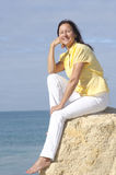 Happy relaxed mature woman ocean Royalty Free Stock Image