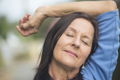 Happy relaxed mature woman outdoor Royalty Free Stock Images