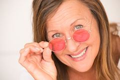 Happy relaxed mature woman red glasses Royalty Free Stock Images