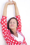 Happy relaxed mature woman white background Stock Photography
