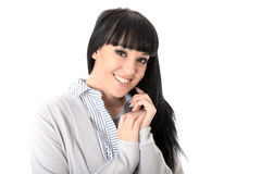 Happy Relaxed Pleased Woman Smiling. Happy Relaxed pleased Young Woman with long black straight hair, and hispanic or european features, looking at camera Stock Photography