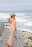 Happy relaxed retired woman ocean beach Stock Image