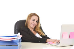 Happy relaxed 40s businesswoman smiling confident working at lap Stock Photo
