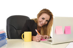 Happy relaxed 40s businesswoman smiling confident working at lap Stock Photography