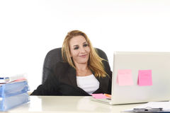 Happy relaxed 40s businesswoman smiling confident working at laptop computer Royalty Free Stock Images