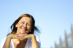 Happy relaxed senior sitting in park III stock photography