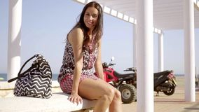 Happy relaxed trendy young woman at the beach stock video footage