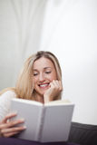 Happy relaxed woman reading a book Royalty Free Stock Photography