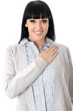 Happy Relaxed Woman Smiling with Hand on Chest Stock Image