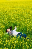 Happy relaxed woman. Happy and relaxed young woman on the flower field Stock Image