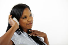 Happy relaxed young lady listening to music Stock Photography