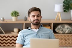 Happy relaxed young man resting with eyes closed breathing air stock photo