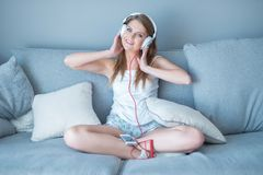 Happy relaxed young woman listening to music Stock Image