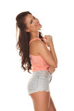 Happy relaxed young woman in skimpy shorts Stock Photo
