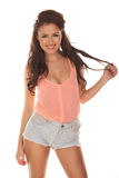 Happy relaxed young woman in skimpy shorts Royalty Free Stock Image