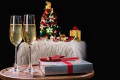 Happy Relaxing at party, Two champagne glasses and sparkle, Chri. Stmas tree ornament on the background Stock Photo