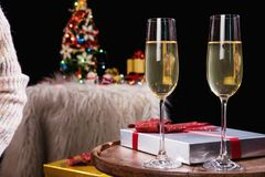 Happy Relaxing at party, Two champagne glasses and sparkle, Chri. Stmas tree ornament on the background Stock Image