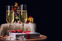 Happy Relaxing at party, Two champagne glasses and sparkle, Chri. Stmas tree ornament on the background Royalty Free Stock Photo