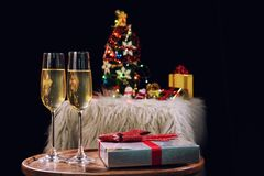 Happy Relaxing at party, Two champagne glasses and sparkle, Chri. Stmas tree ornament on the background Royalty Free Stock Photos