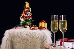 Happy Relaxing at party, Two champagne glasses and sparkle, Chri. Stmas tree ornament on the background Royalty Free Stock Images