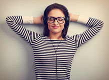 Happy relaxing young woman in headphones listening the calm musi Royalty Free Stock Photo
