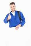 Happy repairman gesturing thumbs up while holding blank billboard Royalty Free Stock Photography
