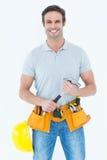 Happy repairman holding hammer Royalty Free Stock Photography