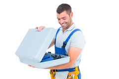 Happy repairman opening toolbox Royalty Free Stock Photography