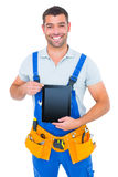Happy repairman in overalls holding digital tablet Royalty Free Stock Photo