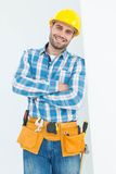 Happy repairman standing arms crossed Royalty Free Stock Image