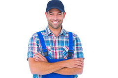 Happy repairman standing arms crossed on white background. Portrait of happy male repairman standing arms crossed on white background Royalty Free Stock Photos