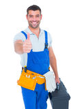 Happy repairman with toolbox gesturing thumbs up Royalty Free Stock Photo