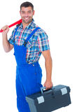 Happy repairman with toolbox and monkey wrench Stock Photography