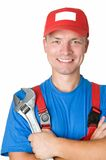Happy repairman worker serviceman. Close-up portrait of happy repairman worker serviceman with adjustable wrench royalty free stock photography