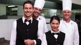 Happy restaurant staff smiling at camera