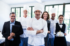 Happy restaurant team standing together in restaurant. Portrait of happy restaurant team standing together in restaurant Royalty Free Stock Photos
