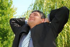 Happy resting businessman outdoor in summer Royalty Free Stock Photo