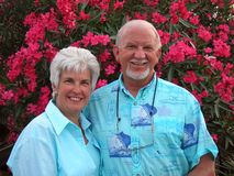 Happy Retired Couple. A happily married retired couple enjoys their vacation, a youthful and active senior couple stock photos