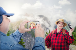 Happy retired couple backpacking in mountains Stock Photo