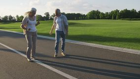 Happy retired couple having fun outdoors stock footage